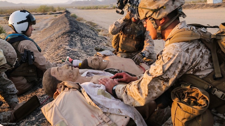 Service members from 1st Marine Division apply first aid to simulated casualties during a Tactical Recovery of Aircraft and Personnel mission in El Centro, Calif., April 28, 2016. The TRAP mission was a part of a Marine Air-Ground Task Force Integration Exercise with units from Marine Aircraft Group 39 as a part of MAG-39's new MAGTF integration effort.