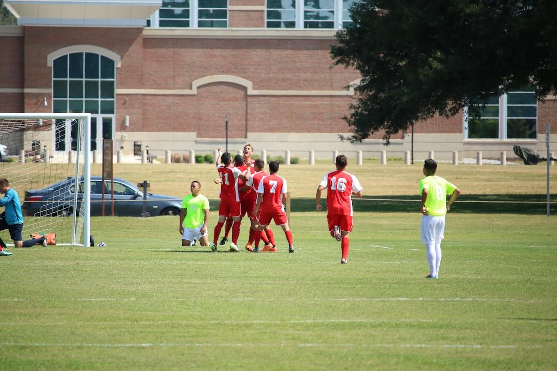 Marines celebrate Cpl Kyle DeSousa's goal at the start of the second half of match five. Navy won the match 2-1 of the 2016 Armed Forces Men's Soccer Championship hosted at Fort Benning, Ga from 6-14 May 2016.  Navy advances to the Championship Match versus Air Force.