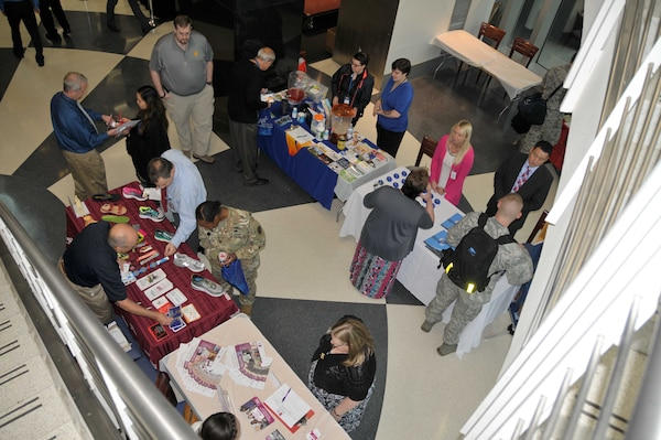 McNamara HQC employees gather information from vendors at the Annual Health and Safety Expo, May 11 in the HQC Café.