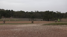 Competitors at the Australian Army Skill at Arms Meeting 2016 fire at the moving target range at Puckapunyal in Victoria, Australia, May 2, 2016. The AASAM tested military marksmen in their capabilities with their service specific weaponry in various scenarios. The first match evaluated competitors' skill in their service specific rifles against moving targets.
