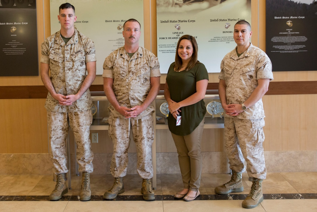 Marines with the 4th Marine Logistics Group Headquarters G-4, Marine Forces Reserve, and a civilian employee with MARFORRES, were honored at the Distinguished Service Awards and Luncheon Program as a part of Public Service Recognition Week, May 4, 2016 at the University of New Orleans. From left to right, Lance Cpl. Coltin J. Kersey, embarkation clerk, Sgt. Justin A. Snapp, maintenance management chief, Mrs. Janet Heriot, customer service support specialist with the MARFORRES Installation Personnel Administration Center, and Maj. John J. Gutierrez, supply officer, were recognized for their hard work and dedication in supporting the Marine Corps, as well as the local community. With the geographical diversity of MARFORRES, Marines have the unique opportunity to interact with the local community and American public on a daily basis. This involvement helps keep the future bright for the Marine Corps and the community as a whole. (U.S. Marine Corps photo by Lance Cpl. Melissa Martens/ Released)