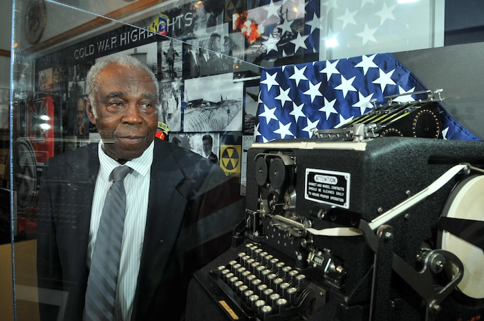 CMSgt (ret) Edward Jolly, Jr, peers through the plexiglass case at a WWII vintage SIGABA decoding machine in the AF ISR Agency Heritage Museum.  Jolly used a machine like this during his early years as cryptographic operator for the USAF Seurity Service in the 1950s.