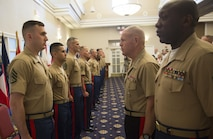 Recruiters and other Marines who made significant contributions to the Corps await to be awarded by Commandant of the Marine Corps Gen. Robert. B. Neller during the Commandant of the Marine Corps Combined Awards Ceremony aboard Marine Corps Base Quantico, Va., on May 11, 2016. Each Marine awarded demonstrated Marine Corps values in ethics, leadership and commitment. Neller awarded each Marine a Navy and Marine Corps Commendation Medal and thanked the families of the awardees for their sacrifices and their support.