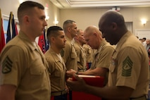 Commandant of the Marine Corps General Robert B. Neller awards Gunnery Sgt. Francisco Soto, the non-prior service recruiter of the year for 2015, with the Navy and Marine Corps Commendation Medal during the Commandant of the Marine Corps Combined Awards Ceremony aboard Marine Corps Base Quantico, Va., on May 11, 2016. Each Marine awarded demonstrated Marine Corps values in ethics, leadership and commitment. Neller thanked the families of the awardees for their sacrifices and their support. Soto is from Recruiting Station San Francisco, 12th Marine Corps District.