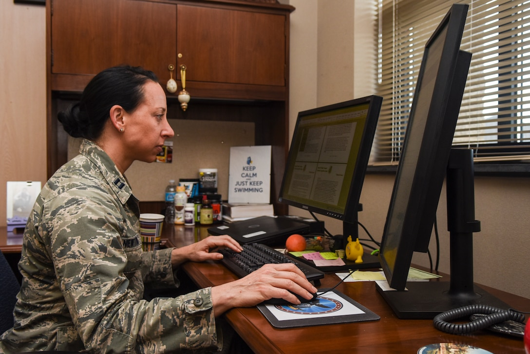 Capt. Leslie Newton, 4th Fighter Wing special victim's counselor, works at her computer, April 8, 2016, at Seymour Johnson Air Force Base, North Carolina. Newton received her commission into the Judge Advocate General program in May 2013 after more than a decade dedicated to her athletic career. (U.S. Air Force photo by Airman Shawna L. Keyes/Released)