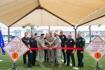 The 45th Security Forces Squadron held a ribbon cutting ceremony to unveil an upgraded military working dog obedience yard at Patrick Air Force Base, Fla., May 11, 2016.The ceremony included a military working dog demonstration and featured Chiefs of Police and local law enforcement K-9 officers from across Brevard County. Among the upgrades include a canopy which lowers the temperature 10 to 20 degrees and keeps the team training year-round all while reducing the impact of rain, sun and heat on our training operations. (U.S. Air Force photos/Matthew Jurgens/Released)