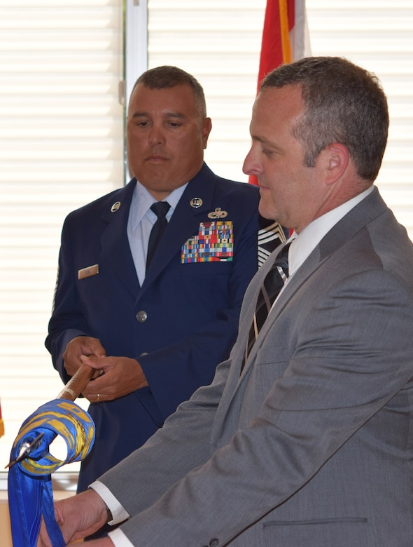 Robert Kraus, the new F-35 Partner Support Complex director, unfurls the unit's guidon during an activation ceremony May 11, 2016, at Eglin Air Force Base, Fla. The complex will provide mission data, intelligence support, lab facilities and training to the eight partner countries purchasing F-35 Lightning II aircraft. (U.S. Air Force photo/1st Lt. Amanda Farr)