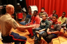 "U.S. Marine Corps Staff Sgt. Eric Kyne, music placement director with the 1st Marine Corps District, visits Columbus Elementary School in Mount Vernon, N.Y. and gives students advice on playing their instrument, May 11, 2016. ""Teaching music to kids is one of the most important jobs you can have as a musician,"" said Kyne. (U.S. Marine Corps photo by Cpl. Brandon Thomas/Released)"