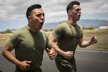 Cpl. Victor Mancilla and Staff Sgt. Christopher Giannetti shout cadence during a first-ever 5K memorial run honoring Cpl. Sara Medina and Lance Cpl. Jacob Hug, aboard Ford Island, Hawaii, May 11, 2016. Marines with U.S. Marine Corps Forces, Pacific and Marine Corps Base Hawaii ran in honor of Medina and Hug, both combat camera Marines, who died one year ago in a helicopter crash while documenting relief efforts in Nepal. Mancilla and Giannetti are both combat camera Marines with MCB Hawaii and MARFORPAC, respectively. (U.S. Marine Corps photo by Sgt. Matthew J. Bragg)