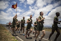 Marines with U.S. Marine Corps Forces, Pacific and Marine Corps Base Hawaii run a first-ever 5K memorial run in honor of Cpl. Sara Medina and Lance Cpl. Jacob Hug, aboard Ford Island, Hawaii, May 11, 2016. Medina and Hug, both combat camera Marines, died one year ago in a helicopter crash while documenting relief efforts in Nepal. Combat camera and public affairs units around the Marine Corps ran a 5K in unison to honor the two fallen Marines. (U.S. Marine Corps photo by Sgt. Matthew J. Bragg)