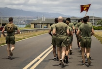 Marines with U.S. Marine Corps Forces, Pacific and Marine Corps Base Hawaii conduct a first-ever 5K memorial run in honor of Cpl. Sara Medina and Lance Cpl. Jacob Hug, aboard Ford Island, Hawaii, May 11, 2016. Medina and Hug, both combat camera Marines, died one year ago in a helicopter crash while documenting relief efforts in Nepal.