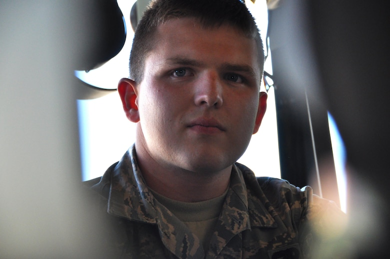 Senior Airman Daniel Carpenter is currently a traditional reservist responsible for physically loading and unloading cargo and passengers into aircraft at Dobbins Air Reserve Base. Carpenter recently received the news of his acceptance into the USAFA, military academy for officer candidates for the U.S. Air Force. (U.S. Air Force photo by Senior Airman Lauren Douglas)