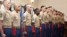 Top performing Marines from throughout the Corps stand at attention after being awarded the Navy and Marine Corps Commendation Medal at the Commandant of the Marine Corps Combined Awards Ceremony May 11, 2016 at Marine Corps Base Quantico, Virginia. The ceremony recognized top performing Marine recruiters, drill instructors, combat instructors, career planners, security guards and athletes.