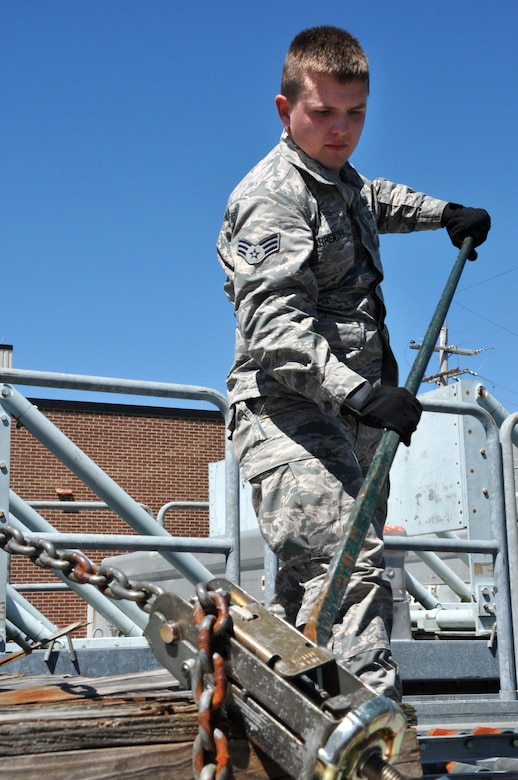 Senior Airman Daniel Carpenter, 80th Aerial Port Squadron air transportation journeyman, uses a tool to unjam an obstruction on a track on a loading dock April 3, 2016 at Dobbins Air Reserve Base. Carpenter was accepted into the Air Force Academy and will start training in July 2016.