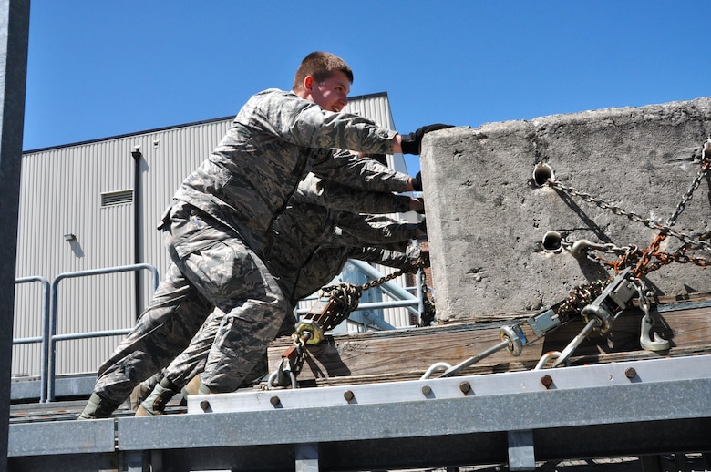 Senior Airman Daniel Carpenter, 80th Aerial Port Squadron air transportation journeyman, works alongside other Airmen to move a large, heavy pallet April 3, 2016 at Dobbins Air Reserve Base. Carpenter recently received the news of his acceptance into the USAFA, military academy for officer candidates for the U.S. Air Force. (U.S. Air Force photo by Senior Airman Lauren Douglas)