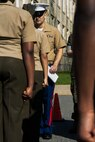 Sergeant Phillip Voss, canvassing recruiter with Recruiting Substation North Boston, Massachusetts, poses Marine Corps knowledge questions to a cadet of the Lynn English High School Junior Reserve Officer Training Corps during a cadet inspection, May 11, 2016. Marine recruiters from the area inspected the high school's cadets in preparation for upcoming JROTC drill competitions.