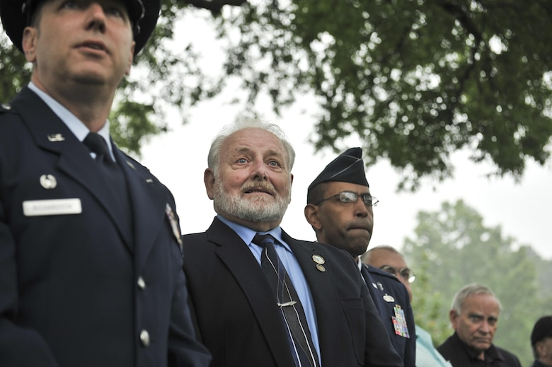 Lt. Col. Timothy Richardson, 94th Intelligence Squadron commander, and retired Chief Master Sgt. Tom Nurre listen to the choir sing 'Amazing grace' during a Baron 52 wreath-laying ceremony May 11, 2016 at Arlington, Va. he ceremony has been held since 1995 to honor the fallen Airmen of the 6994th Security Squadron and 361st Tactical Electronic Warfare Squadron during the Vietnam War. (U.S. Air Force photo/Staff Sgt. Alexandre Montes)