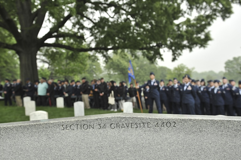 Airmen from the 94th Intelligence Squadron veterans of the 6994th Security Squadron, 361st Tactical Electronic Warfare Squadron and guest stand as closing remarks are made during a Baron 52 wreath-laying ceremony May 11, 2016 at Arlington, Va. The ceremony has been held since 1995 to honor the fallen Airmen of the 6994th SS during the Vietnam War. (U.S. Air Force photo/Staff Sgt. Alexandre Montes)