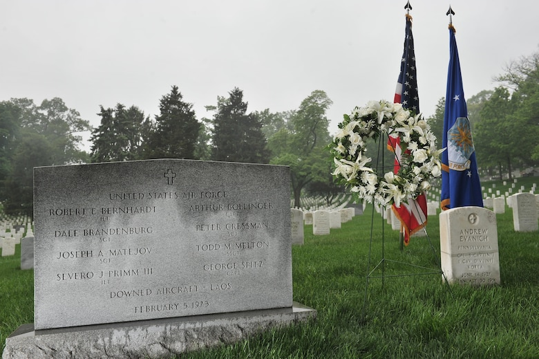 "A wreath rest next to a grave marker of several 6994th Security Squadron and 361st Tactical Electronic Warfare Squadron airmen who went by a motto of ""Unarmed, Alone and Unafraid"" as they flew on an EC-47 unarmed World War II aircraft during the Vietnam War. Their intelligence collecting missions were key to identifying advisories with the use of Airborne Radio Direction Finding (ARDF) equipment in the back of an EC-47. The missions they conducted helped pave the way for intelligence operations in today's Air Force. (U.S. Air Force photo/Staff Sgt. Alexandre Montes)"