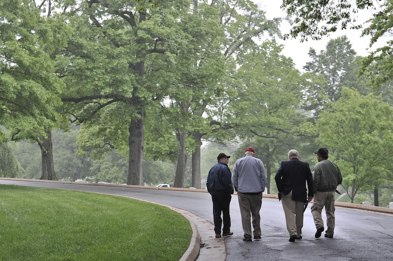 "Several 6994th Security Squadron and 361st Tactical Electronic Warfare Squadron veterans walk through the Arlington National Cemetery after attending a Baron 52 wreath-laying ceremony May 11, 2016 at Arlington, Va. The 6994th SS 'Back-enders' and 361st TEWS went by a motto of ""Unarmed, Alone and Unafraid"" as they flew on an EC-47 unarmed World War II aircraft during the Vietnam War. Their intelligence collecting missions were key to identifying advisories with the use of Airborne Radio Direction Finding (ARDF) equipment in the back of an EC-47. (U.S. Air Force photo/Staff Sgt. Alexandre Montes)"