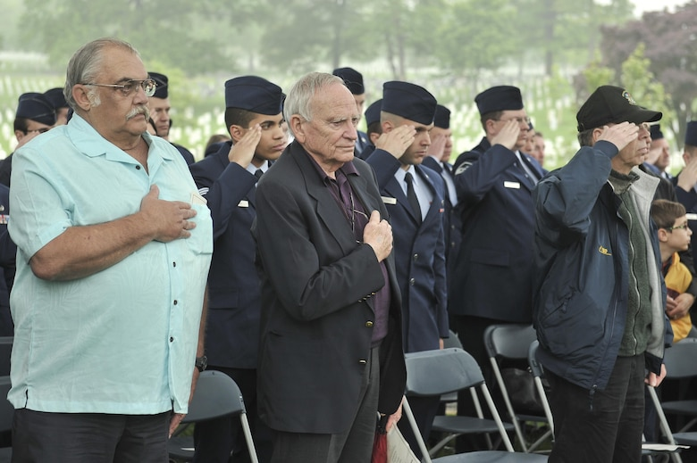 """Several 6994th Security Squadron and 361st Tactical Electronic Warfare Squadron veterans pay their respects as a wreath is laid during a Baron 52 wreath-laying ceremony May 11, 2016 at Arlington, Va. The 6994th SS 'Back-enders' and 361st TEWS went by a motto of """"Unarmed, Alone and Unafraid"""" as they flew on an EC-47 unarmed World War II aircraft during the Vietnam War. Their intelligence collecting missions were key to identifying advisories with the use of Airborne Radio Direction Finding (ARDF) equipment in the back of an EC-47. (U.S. Air Force photo/Staff Sgt. Alexandre Montes)"""