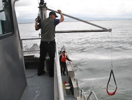 Kixon Meyer, captain of the M/V John A. B. Dillard, Jr., operates a newly-installed davit system May 5. The Dillard crew conducted three days of rescue swimmer training in the San Francisco Bay May 3-5.