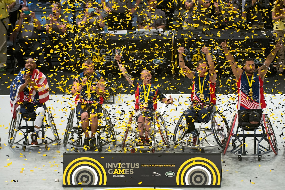 U.S. wheelchair basketball team members celebrate their gold medal win during the 2016 Invictus Games in Orlando, Fla., May 12, 2016. DoD photo by Edward Joseph Hersom II