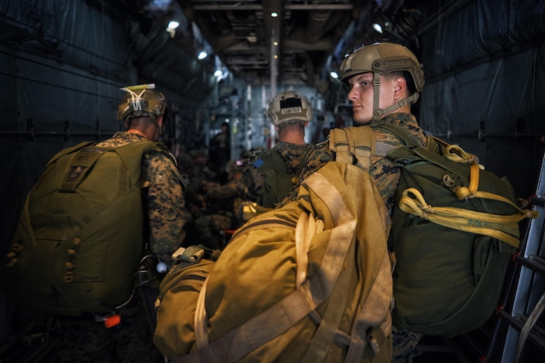Marines with the 3rd Reconnaissance Battalion, 3rd Marine Division, III Marine Expeditionary Force, board a C-130 Hercules for jump training at Yokota Air Base, Japan, May 11, 2016. The training allowed Marines to practice jumping while also allowing Yokota aircrews to practice flight tactics and timed-package drops. (U.S. Air Force photo by Senior Airman Delano Scott/Released)