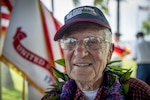Charles Wolf, a World War ll veteran, smiles after a surprise ceremony held in his honor, at the Pearl Harbor Education Center, Hawaii, May 6, 2016. Wolf was presented a shadow box containing awards and medals by  Brig. Gen. Mark Spindler, Deputy Director of the Defense POW/MIA Accounting Agency (DPAA). After 72 years Wolf received the recognition he deserved for serving his country so many years ago. DPAA's mission is to provide the fullest possible accounting for our missing personnel to their families and the nation. (DoD photo by MC2 Aiyana Paschal/RELEASED)
