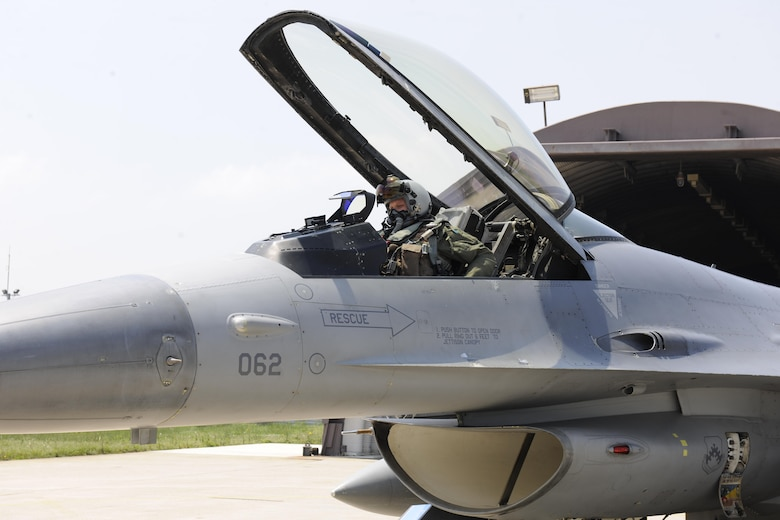 Major Baiyln Beck, 8th Fighter Wing Director of Staff, climbs into an F-16 Fighting Falcon at Kunsan Air Base, ROK, for Exercise Buddy Wing 16-4, May 11, 2016. Buddy Wing exercises are conducted at various ROKAF and U.S. Air Force bases multiple times throughout the year in order to practice interoperability between the U.S. and the ROKAF. (U.S. Air Force photo by Senior Airman Dustin King/Released)