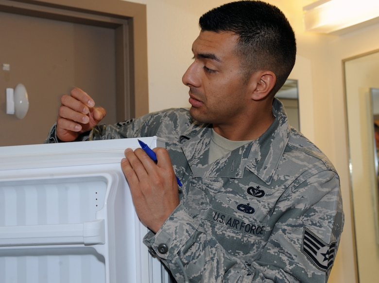 Staff Sgt. Marcos Campos, 28th Civil Engineer Squadron airman dorm leader, inspects an Airman's dorm room at Ellsworth Air Force Base, S.D., April 14, 2016. As part of an Airman's out-processing checklist, their room must be inspected to ensure the conditions of the room are in the same shape as when the Airman first arrived. (U.S. Air Force photo by Airman 1st Class Denise M. Nevins/Released)