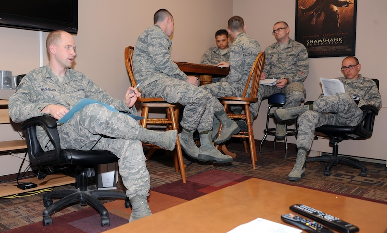 Staff Sgt. Alex Washburn, 28th Civil Engineer Squadron airman dorm leader, gives a dorm in-processing brief to a group of new Airmen at Ellsworth Air Force Base, S.D., April 13, 2016. The ADLs ensure new first term Airmen arriving at Ellsworth receive this brief to understand the rules and policies of living in the dormitories, including restrictions on having guests and the types of authorized pets in the dorms. (U.S. Air Force photo by Airman 1st Class Denise M. Nevins/Released)