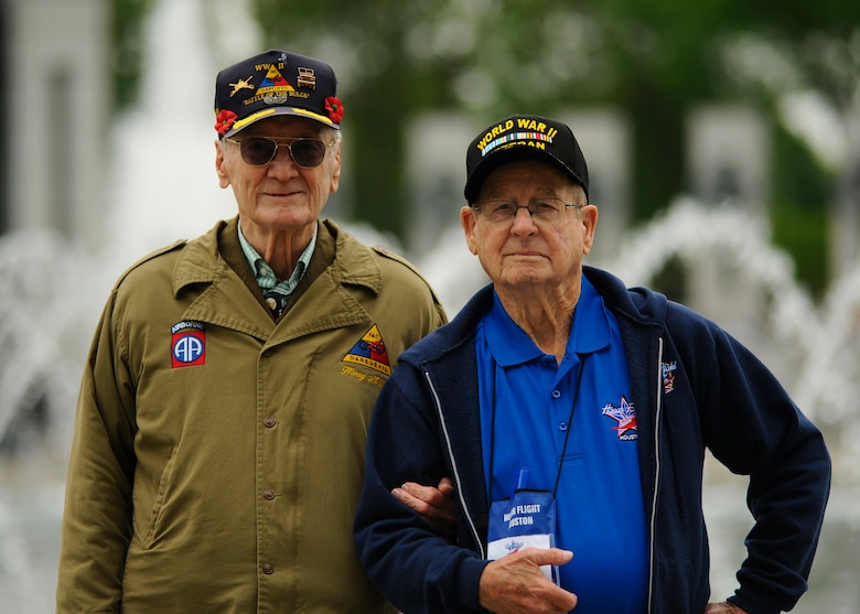 Harold Bradley and Harry Miller, both World War II Army veterans, reunite during an honor flight trip at the National World War II Memorial in Washington D.C., April 30, 2016. Bradley and Miller served in the same unit for the Army at the Battle of the Bulge and were able to reunite when Bradley was selected to participate with Honor Flight Houston. (U.S. Air Force photo/Tech. Sgt. Bryan Franks)