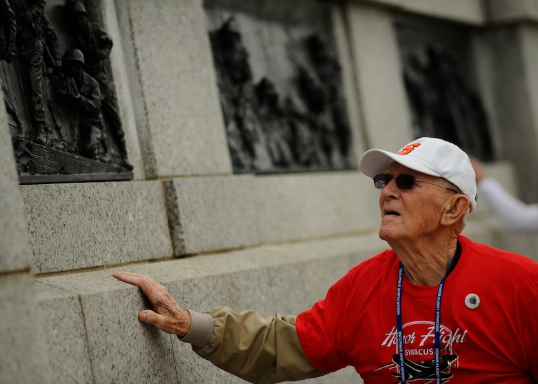 Paul Bowker, a World War II Army veteran, views the bronze artwork depicting the battles fought during World War II as he heads to the heart of the National World War II Memorial in Washington, D.C., April 30, 2016. Bowker is part of the Honor Flight Network's Syracuse flight. (U.S. Air Force photo/Tech. Sgt. Bryan Franks)