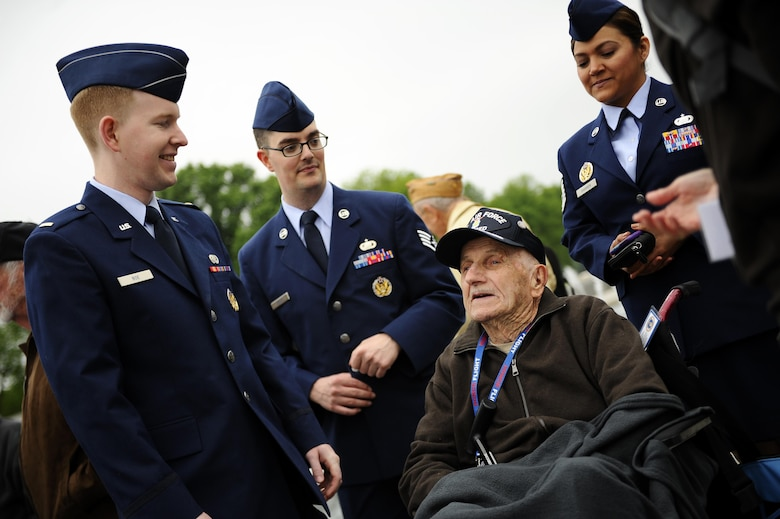 Airmen visit with a World War II veteran from the Georgia Honor Flight at the National World War II Memorial in Washington, D.C., April 30, 2016. The Georgia Honor Flight was one of many such flights to visit the nation's capital. Upon their arrival, flight members were greeted by military personnel, Honor Flight volunteers and well-wishers (U.S. Air Force photo/Tech. Sgt. Bryan Franks)