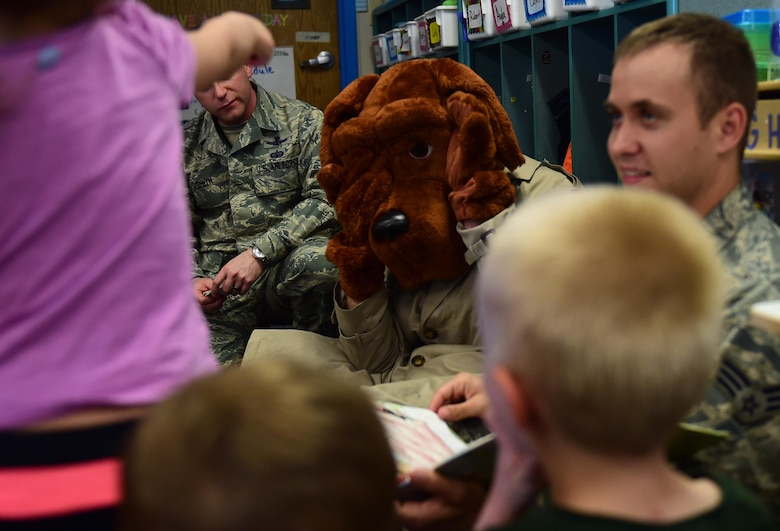 McGruff the Crime Dog acts out a portion of a book for Buckley Air Force Base children May 9, 2016, at the Crested Butte Child Development Center on Buckley AFB, Colo. McGruff, created by the National Crime Prevention Council more than 30 years ago, provides safety tips for adults and children about violence and drugs. (U.S. Air Force photo by Airman 1st Class Gabrielle Spradling/Released)