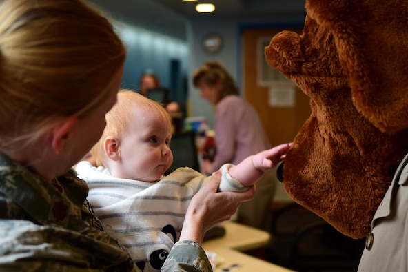 A Buckley Air Force Base child interacts with McGruff the Crime Dog May 9, 2016, at the Crested Butte Child Development Center on Buckley AFB, Colo. McGruff visited with children for Police Week which salutes those who aim to maintain public safety every day. (U.S. Air Force photo by Airman 1st Class Gabrielle Spradling/Released)