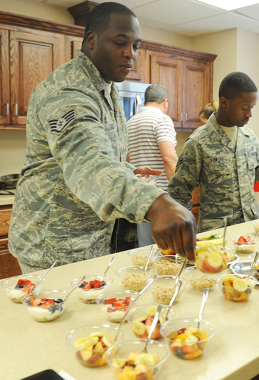 Dorm airmen sample the first goodies made in their new kitchen, May 9, 2016. (U.S. Air Force photo by Tommie Horton)