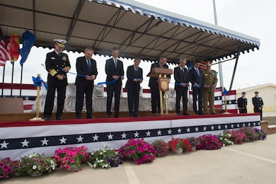 Deputy Defense Secretary Bob Work, fourth from right, Romanian Prime Minister Dacian Julien Ciolos, fourth from left, and the official party at the Aegis Ashore Inauguration Ceremony cut a ribbon to officially open the defense system in Deveselu, Romania, May 12, 2016. DoD photo by Navy Petty Officer 1st Class Tim D. Godbee