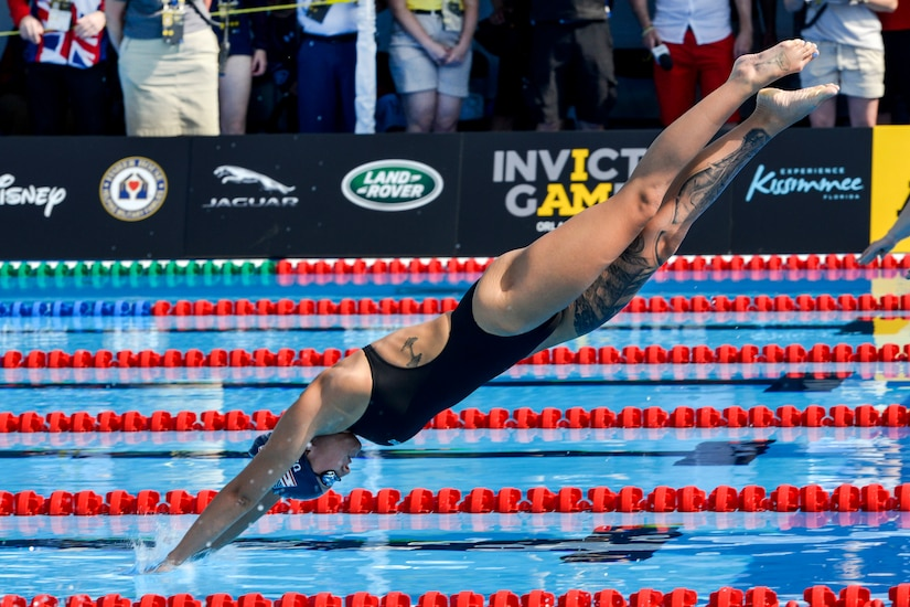 Army Sgt. Elizabeth Marks enters the water in the breaststroke finals at the 2016 Invictus Games in Orlando, Fla., May 11, 2016. Air Force photo by Senior Master Sgt. Kevin Wallace