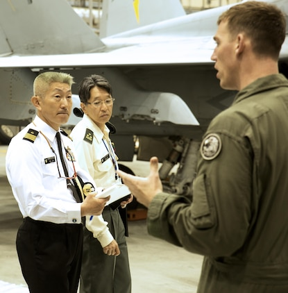 U.S. Marine Corps Maj. Elisha Keller, training officer with Marine All-Weather Fighter Attack Squadron (VMFA(AW)) 242, explains air support operations to Japan Ground Self-Defense Force Col. Mitsuhiko Nakadai and Japan Maritime Self-Defense Force Capt. Atsushi Tanaka, instructors from the Japanese Joint Staff College, during their visit to Marine Corps Air Station Iwakuni, Japan, May 9, 2016. The Japanese Joint Staff College instructors visited MCAS Iwakuni to learn about Marine Air-Ground Task Force operations. (U.S. Marine Corps photo by Lance Cpl. Donato Maffin/Released)