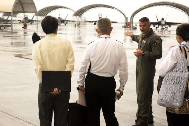 U.S. Marine Corps Lt. Col. William Millet, Marine Aircraft Group (MAG) 12 operations officer, shows instructors from the Japanese Joint Staff College the Marine All Weather Fighter Attack Squadron (VMFA(AW)) 242, F/A-18 aprons at Marine Corps Air Station Iwakuni, Japan, May 9, 2016. The Japanese Joint Staff College instructors visited MCAS Iwakuni to learn about Marine Air-Ground Task Force operations. (U.S. Marine Corps photo by Lance Cpl. Donato Maffin/Released)