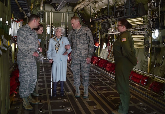 Ms. Selma Van de Perre, 92-year-old Holocaust survivor, tours the inside of C-130J Super Hercules at Ramstein Air Base, Germany, May 6, 2016. Van de Perre, took a  tour of the base after she told her story of survival during the 2016 Holocaust remembrance event. (U.S. Air Force photo/Tech Sgt. Sara Keller)