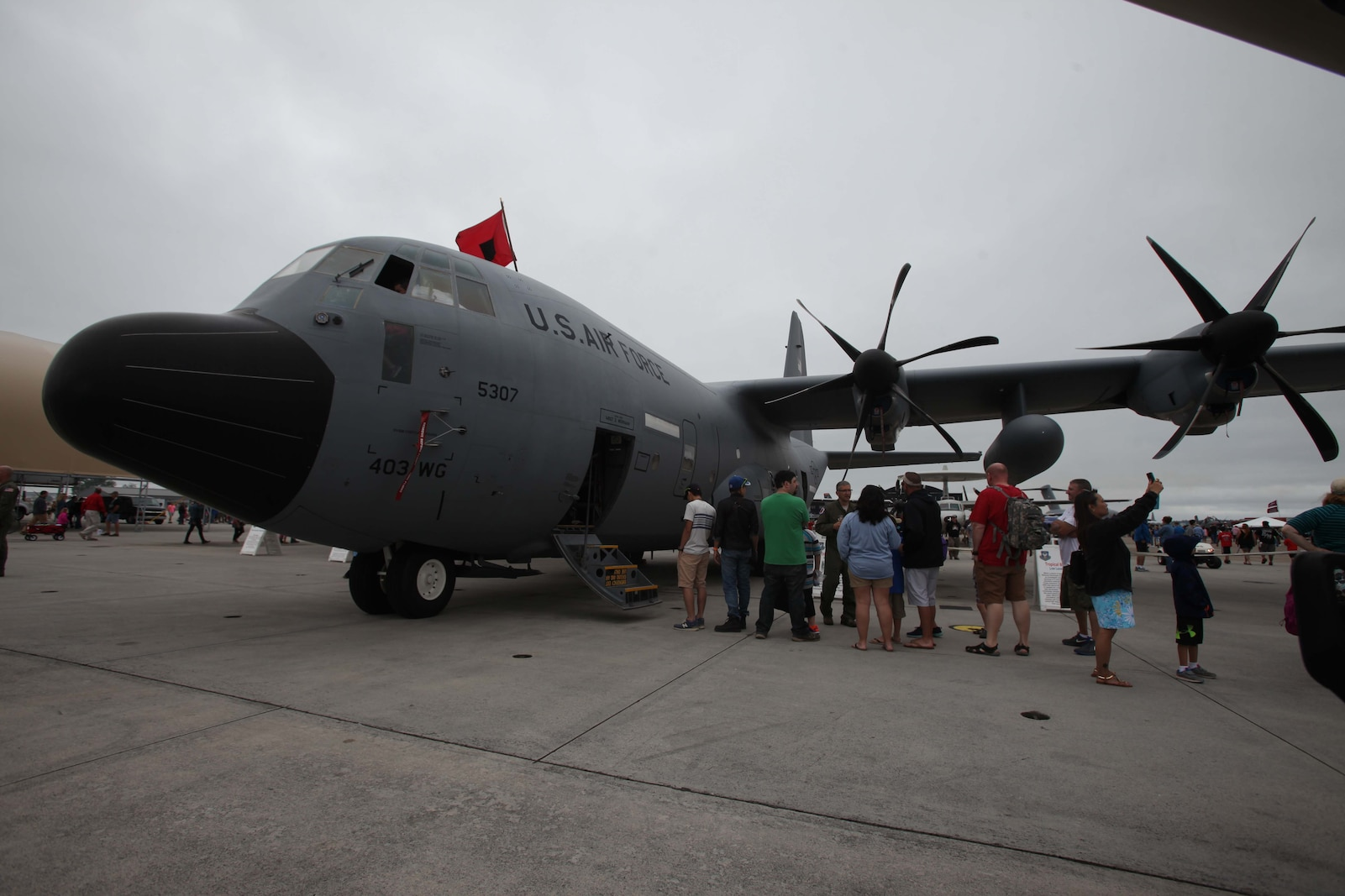 """A WC-130 """"Hurricane Hunter"""" is presented to a crowd at the 2016 Marine Corps Air Station Cherry Point Air Show – """"Celebrating 75 Years"""" at MCAS Cherry Point, N.C., April 30, 2016. The WC-130 is a high-wing, medium-range aircraft used for weather reconnaissance missions by the United States Air Force. The aircraft is a modified version of the C-130 Hercules transport configured with specialized weather instrumentation used for penetration of tropical cyclones and winter storms to obtain data on movement, size and intensity. This year's air show celebrated MCAS Cherry Point and 2nd Marine Aircraft Wing's 75th anniversaries and featured 40 static displays, 17 aerial performers and a concert. #CPAirShow2016 #Marines"""