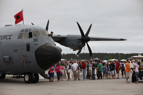 "A WC-130 ""Hurricane Hunter"" is presented to a crowd at the 2016 Marine Corps Air Station Cherry Point Air Show – ""Celebrating 75 Years"" at MCAS Cherry Point, N.C., April 30, 2016. The WC-130 is a high-wing, medium-range aircraft used for weather reconnaissance missions by the United States Air Force. The aircraft is a modified version of the C-130 Hercules transport configured with specialized weather instrumentation used for penetration of tropical cyclones and winter storms to obtain data on movement, size and intensity.