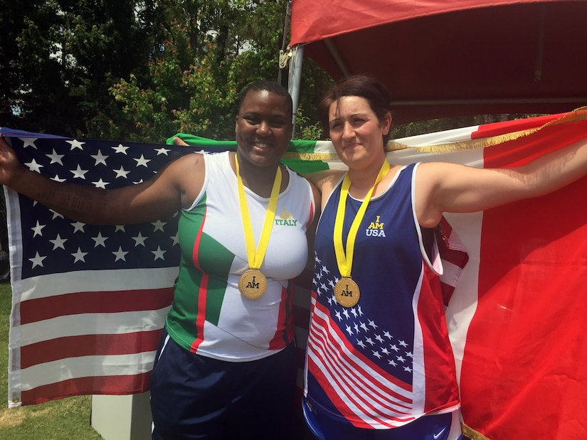 Medically retired Army Sgt. Monica Southall celebrates with 1st Maj. Cpl. Pellegrina Caputo of the Italian army after they both received gold medals in shot put in their respective disability categories during the track and field competition at the 2016 Invictus Games at the ESPN World Wide of Sports Complex at Walt Disney World, Orlando, Fla., May 10, 2016. Caputo asked Southall to trade jerseys to share in the camaraderie of the games, and she happily accepted. DoD photo by Shannon Collins