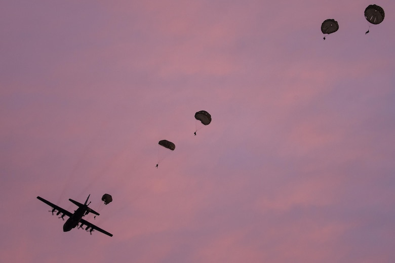 Marines jump from an Air Force C-130 Hercules at Yokota Air Base, Japan, May 11, 2016, during Jump Week. The Marines were from the 3rd Reconnaissance Battalion, 3rd Marine Division, III Marine Expeditionary Force and the C-130 was assigned to the 36th Airlift Squadron at Yokota AB. The training not only allowed the Marines to practice jumping, but it also allowed the Yokota aircrews to practice flight tactics and timed-package drops. (U.S. Air Force photo/Yasuo Osakabe)