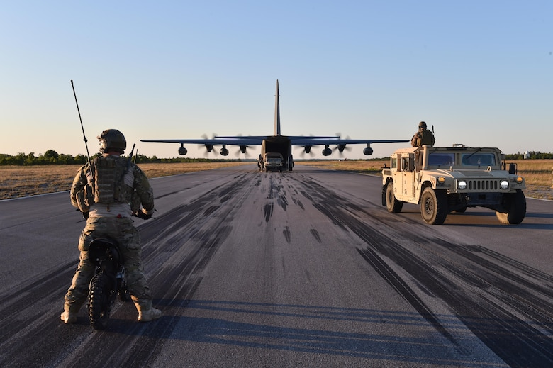 Airmen transport simulated patients to a MC-130J Commando II at Eglin Range, Fla., May 4, 2016, during exercise Emerald Warrior 16. Emerald Warrior is a U.S. Special Operations Command-sponsored mission rehearsal exercise during which joint special operations forces train to respond to real and emerging worldwide threats. (U.S. Air Force photo/Senior Airman Logan Carlson)