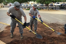 Col. Doug Gilpin, 27th Special Operations Mission Support Group commander, digs with another Air Commando outside Building 600 as part of Wing Beautification Day May 13, 2016, at Cannon Air Force Base, N.M. Air Commandos across the 27th Special Operations Wing stepped out of their work centers to demonstrate a pride epidemic for their installation. (U.S. Air Force photo/Staff Sgt. Alexx Pons)