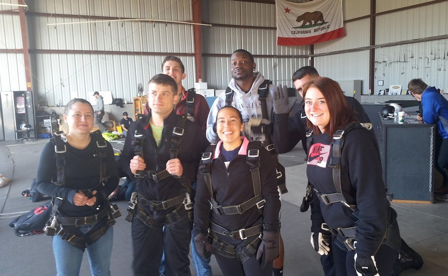 """Airmen from Team Vandenberg gear up during """"Leap of Faith"""" program, April 30, 2016, Lompoc, Calif. The half-day program included a tandem parachute jump from an altitude of 13,000 feet, allowing ones spiritual faith to provide stability even if your life is in free fall."""